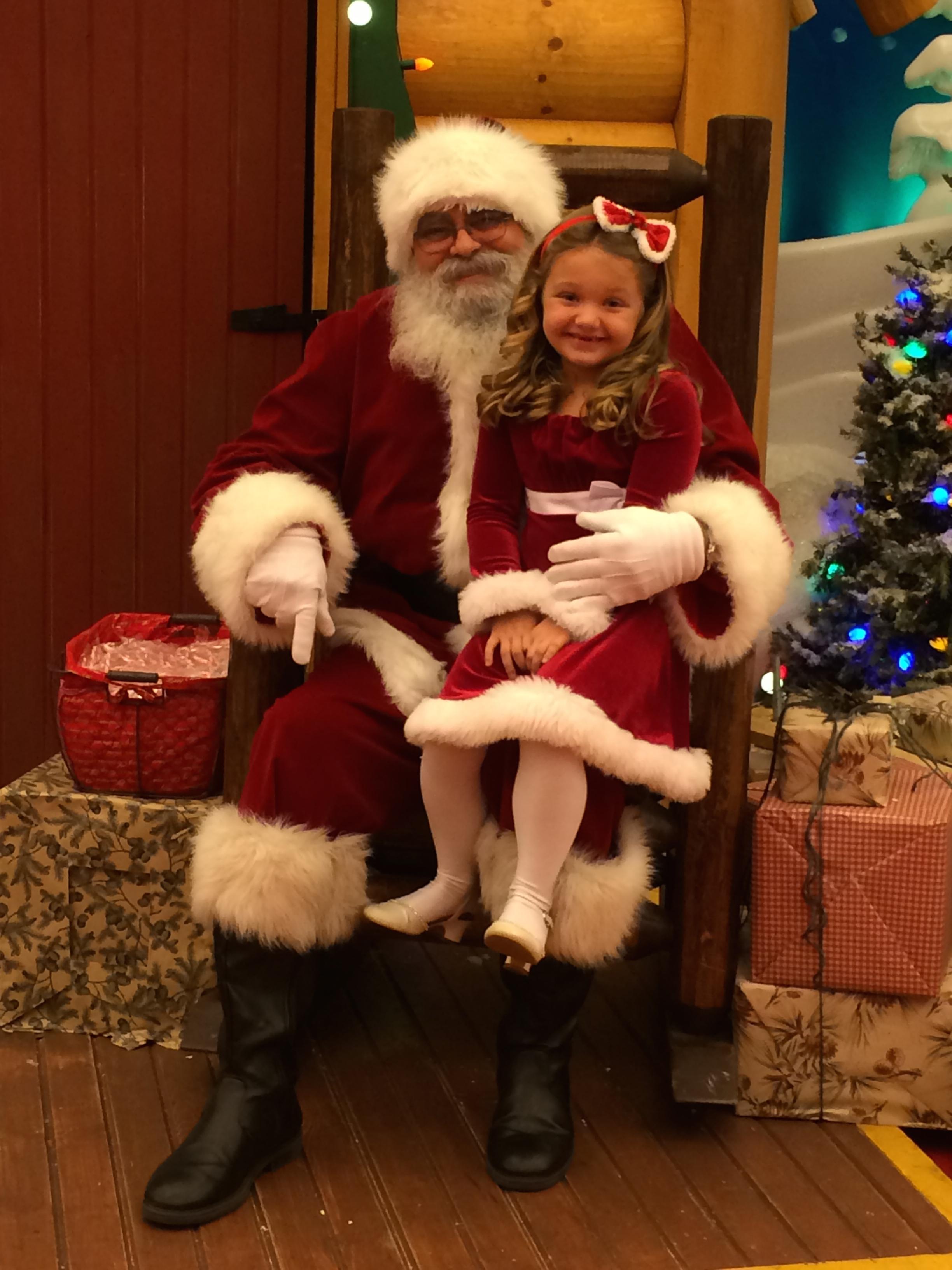 real magic-child sitting on santa's lap