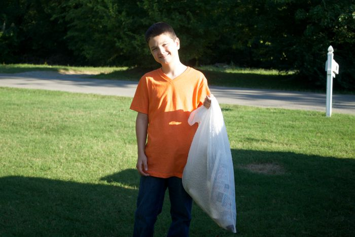 kid taking out trash
