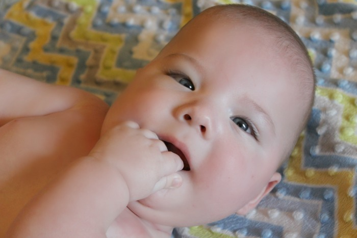 Cute baby eating hand